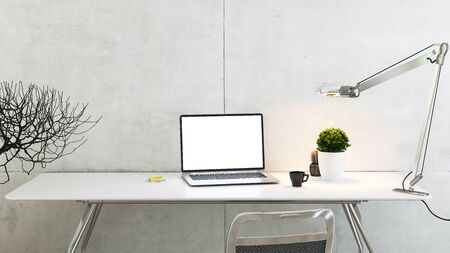 laptop on office table with plant, desk lamp, coffee cup and concrete wall 3D rendering Reklamní fotografie