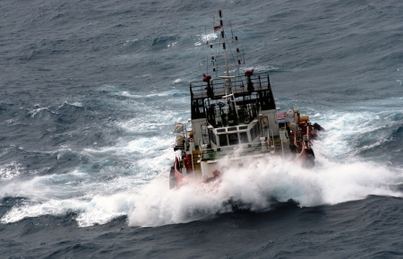 offshore vessel at sea during monsoon seasoon photo
