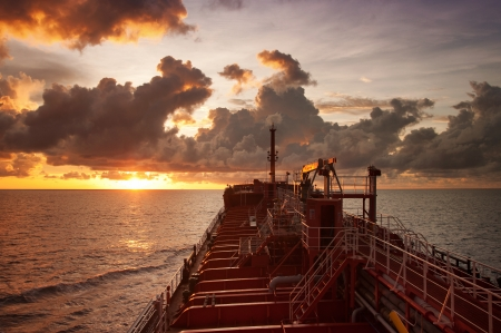 oil tanker en route to next port during sunset photo