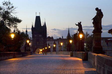Prague - Charles bridge in morning and lamps photo