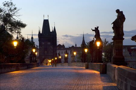 Prague - Charles bridge in morning and lamps photo