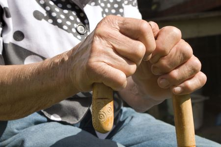 senescence: hands of old woman with stick