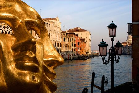 Venice - gold mask and canal grande in evening  photo