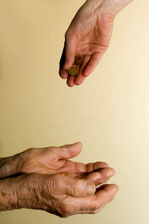 poor woman:  hand of old and young woman with the money  Stock Photo