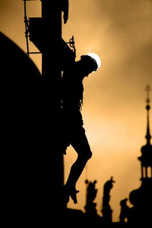 christendom:  Prague cross on the charles bridge by sunrise - silhouette