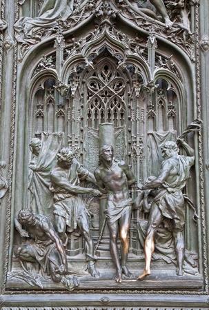flagellation: Milan - detail from main bronze gate - flagellation of Christ - Pogliaghi 1906  Stock Photo