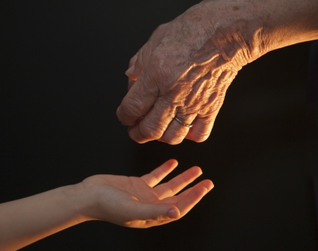 hand of old woman and child  Stock Photo