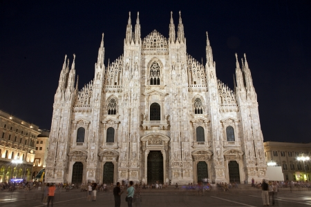 Milan - westfacade of cathedral at night  photo