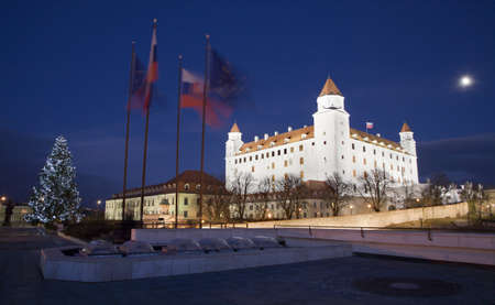 bratislava - castle from parliament at night and christmas tree and flags