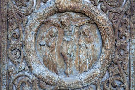 Paris - detail from main gate of Saint Denis -   Jesus on the cross
