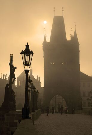 Prague - Charles bridge in the morning fog  photo