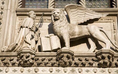 Venice - lion of St  Marc the Evengelist from portal of st  Mark basilica  Stock Photo