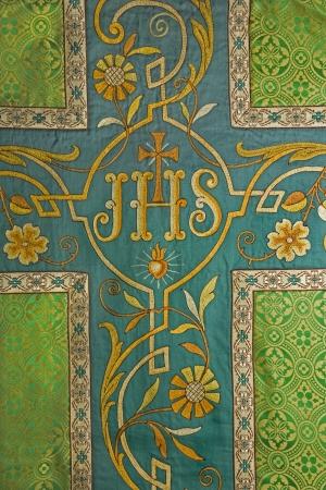 vestment: cross - detail of green catholic vestment  Stock Photo