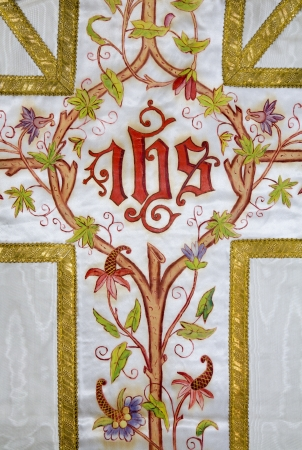 vestment:  cross - detail of old painted catholic vestment  Stock Photo