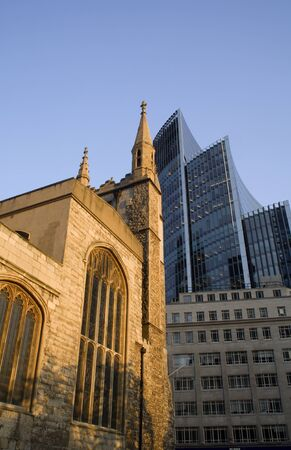 willis:  London - Willis building and old gothic house by sunset light  Stock Photo