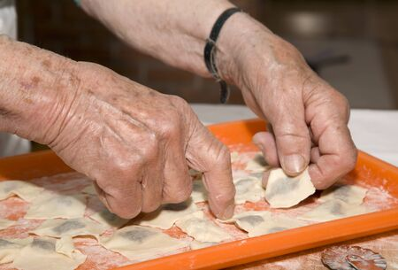 hands of old woman baking photo