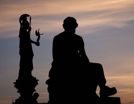 Vienna - silhouette of philosopher statue and Athena funtain  Stock Photo - 15902135