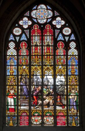 martyrdom: BRUSSELS - JUNE 22 Scene of martyrdom from Windowpane in st  Michael s gothic cathedral on June 22, 2012 in Brussels  Editorial