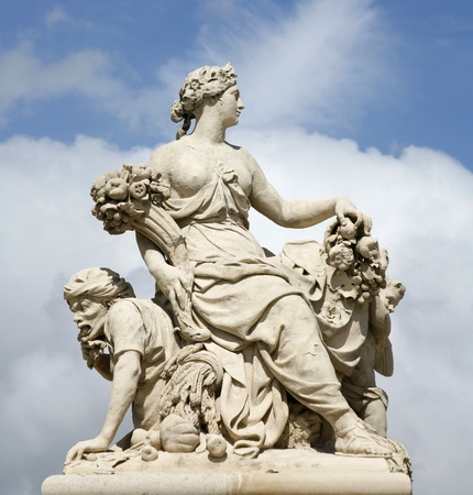 statuary garden: Paris - statue by entry of Versailles palace Editorial