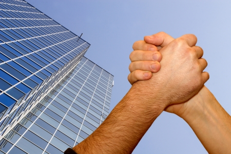congruence: Emulation of men and skyscraper  Stock Photo