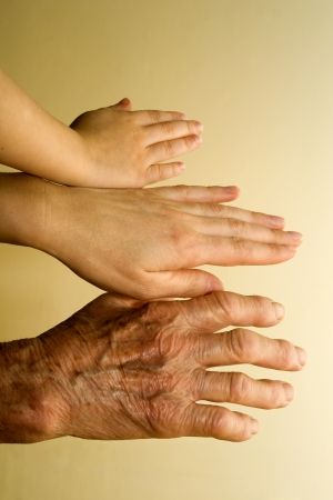 senescence: hands of generations Stock Photo