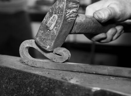forgeman: hand of smith at work