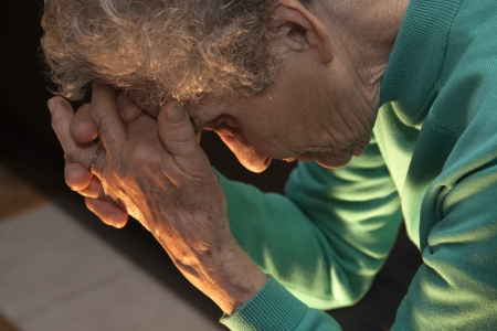 meditation help: meditation of old woman at candle light