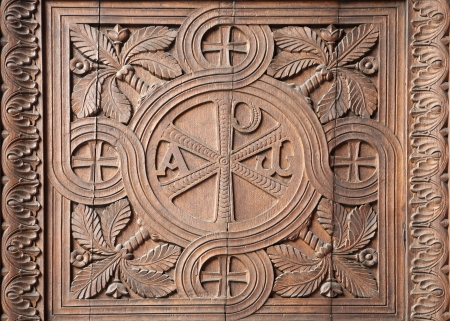 christus: Milan - detail from church gate - carving od Christ monogram