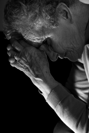 meditation of old woman by the candle photo