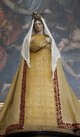 BRUSSELS - JUNE 21: Virgin Mary statue in the needlework garments from side altar at st. Nicholas church on June 21, 2012 in Brussels.