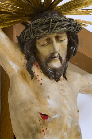 Jesus on the cross - wood carving from Vienna church photo