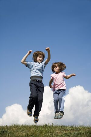 jump of children on the sky background Stock Photo - 16934140