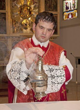 vestment: catholic priest at incense of altarcatholic priest at incense of altar