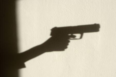 maffia: shadow of hand with the gun