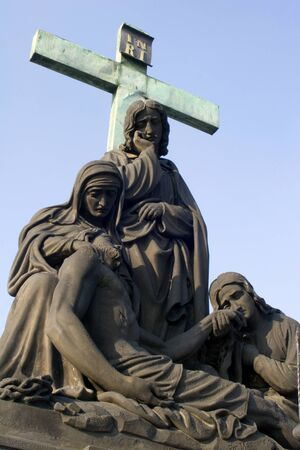 statue of Deposition of Christ in Prague - Charles Bridge  photo