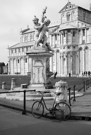 religiosity:  Pisa - statue of angles and cathedral - piazza dei miracoli  Stock Photo