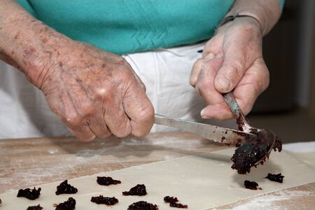 senescence: grandmother hands at baking Stock Photo