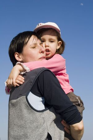 embracement:  Love of mother and child on the sky