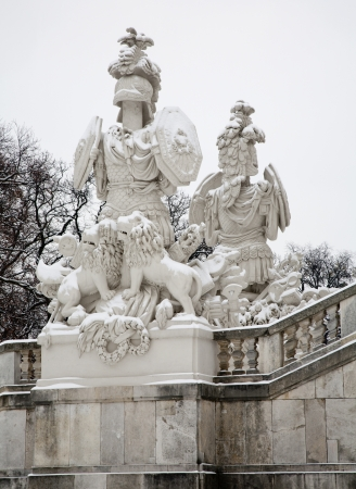 the gloriette: Vienna - Gloriette in Schonbrunn palace and statue of guardians in winter  Built in 1775 designed by architect Johann Ferdinand Hetzendorf von Hohenberg