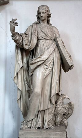 VIENNA - JANUARY 15  Statue of st  John the Evangelist in Minoriten church on January 15, 2013 in Vienna photo
