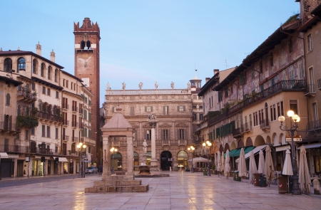 Verona - Piazza Erbe in morning dusk and Porta Leona and Palazzo Maffei in backgroud Stock Photo