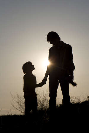 mother and child in sunset - outdoor - silhouette  photo