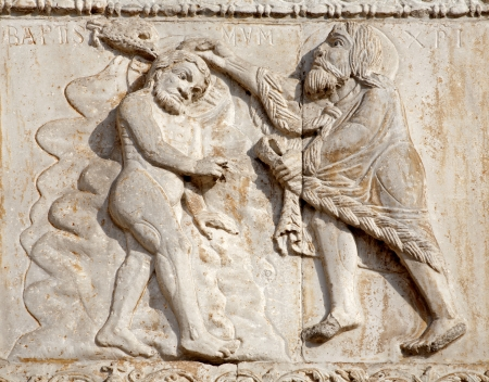 VERONA - JANUARY 27: Baptism of Jesus from romanesque Basilica San Zeno. Relief is work of the sculptor Nicholaus and his workshop on January 27, 2013 in Verona, Italy. Stock Photo - 18079450