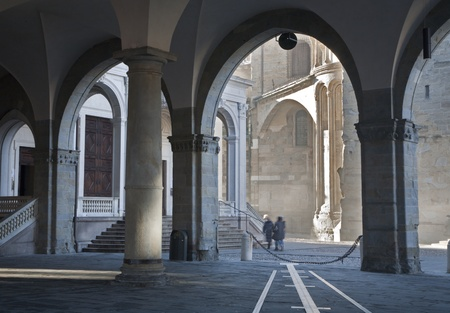 Bergamo - rays betwin Duomo and cathedral under arch in upper town photo