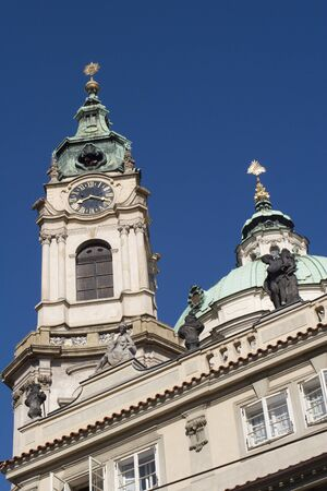 st nicholas cathedral: Prague - tower of st  Nicholas baroque church Stock Photo