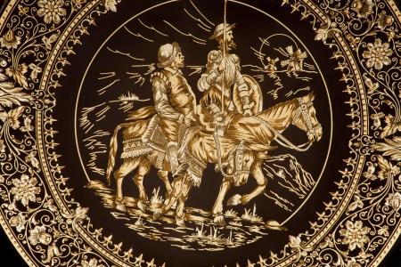 don quijote: Toledo - Detalle de la placa de damasquinado t�pico con el Don Quijote y Sancho Panza artesan�as tradicionales hacen