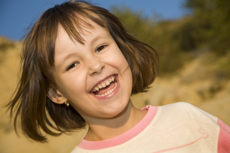 atractive: atractive smile of little girl in the wind  Stock Photo