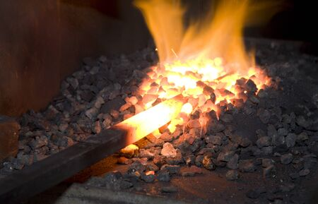 smithy: iron in the hearth - detail from smithy Stock Photo