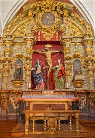 TOLEDO - MARCH 8  Crucifixion baroque statue with hl  Mary and saint John from church Iglesia de san Idefonso on March 8, 2013 in Toledo, Spain