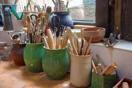 detail from pottery work room - brushes and tools photo